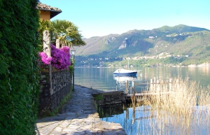 Houses on one side, boats on the other and Lake Orta's clear, calm water right beside us.