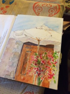 Patricia Boyd is our resident artist.  While I'm blogging, she's doing her water color of the best site in her mind...it's our back yard umbrella.  Bella.