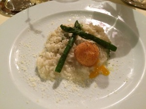 An Italian staple of risotto with asparagus and a soft-boiled, yet breaded egg on the top there.  What a symphony of flavors.