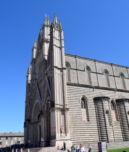 It is positioned near the Tufa cliffs of the hill town; so you can see the Duomo from miles around.