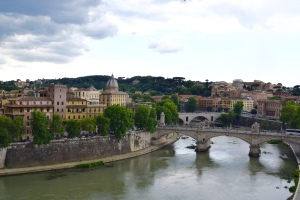 From the battlements, you can see down the Tiber to some more domed monuments.  And, over to the right, you can see St. Peter's dome.  They made a secret passageway for the Pope to escape an attack on the Vatican and come here to be protected.