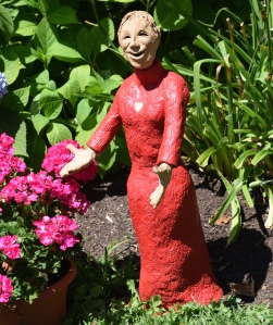 This sculptor is famous here.  She has a studio nearby and many installations in the village. This one is about 2 feet tall; some are life size.