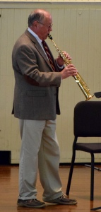 This soprano saxophonist accompanied the organ music and sounded great.