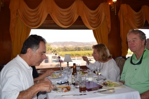 Joe Mondelli on the left plus Julie and Tim O'Neill enjoy the repast and the views from our restored railroad car. About a 3 hour tour.