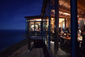 a photo of the main dining room from the outside bar. Hanging about a football field above the sea...and it's ALL glass.